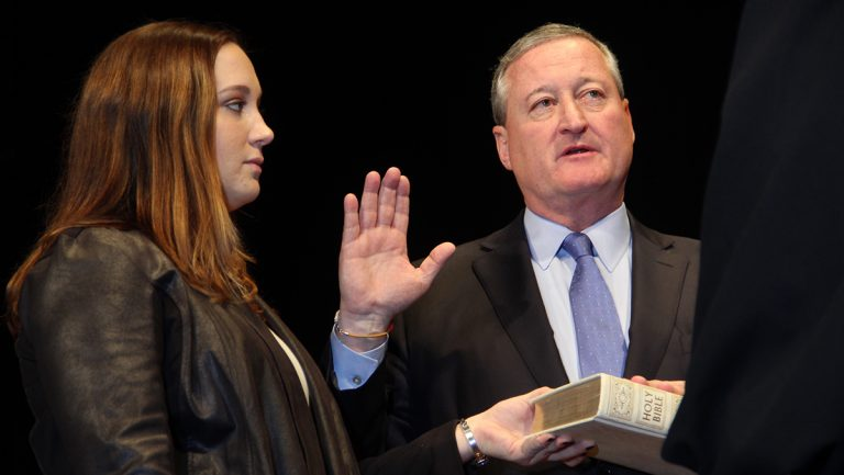 Jim Kenney is sworn in as mayor at the Academy of Music while his daughter Nora holds the Bible. (Emma Lee/WHYY)