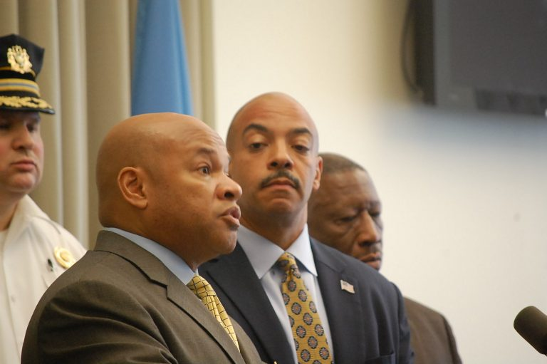 DEA agent Gary Tuggle talks about the bust as District Attorney  Seth Williams looks on. (Tom MacDonald/ WHYY)