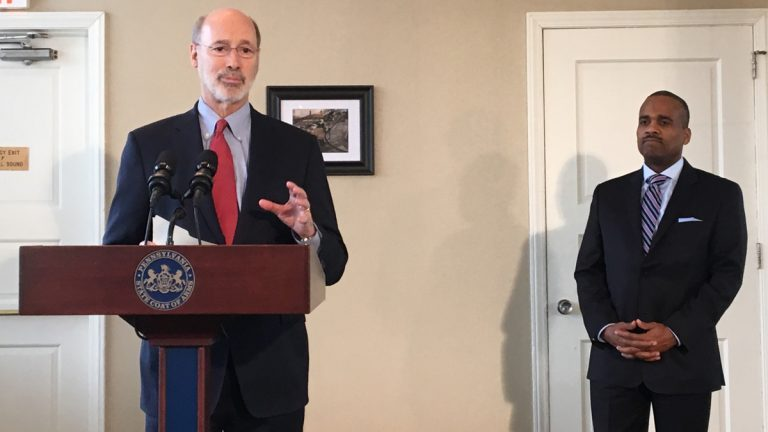 Pennsylvania Gov. Tom Wolf announces the fund consolidation at a press conference alongside Timothy Reese
