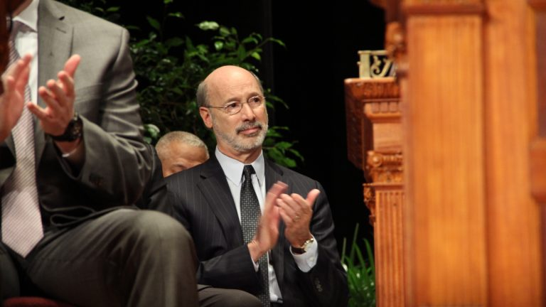 Gov. Tom Wolf applauds during inaugural ceremonies Monday for Philadelphia Mayor Jim Kenney. (Emma Lee/NewsWorks)