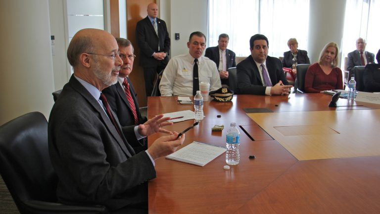 Gov. Tom Wolf presides over a meeting at Temple University's medical school discussing ways to combat opioid addiction. (Emma Lee/WHYY)