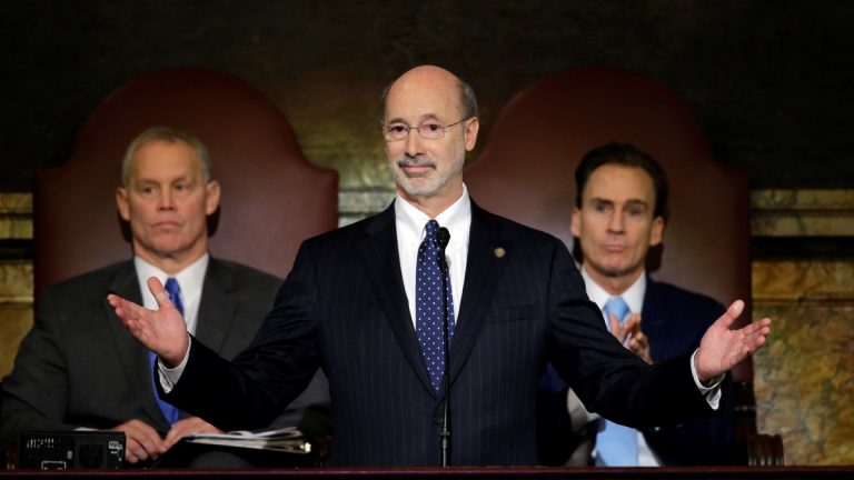 Gov. Tom Wolf delivers his budget address for the 2015-16 fiscal year to a joint session of the Pennsylvania House and Senate Tuesday in Harrisburg. Behind him are the Speaker of the House of Representatives Mike Turzai, R-Allegheny, left, and Lt. Gov. Michael Stack, is at right. (Matt Rourke/AP Photo)