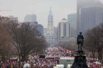 Thousands gathered on the Ben Franklin Parkway the morning of Saturday, January 21, for the Women's March in Philadelphia. (Brad Larrison for NewsWorks)