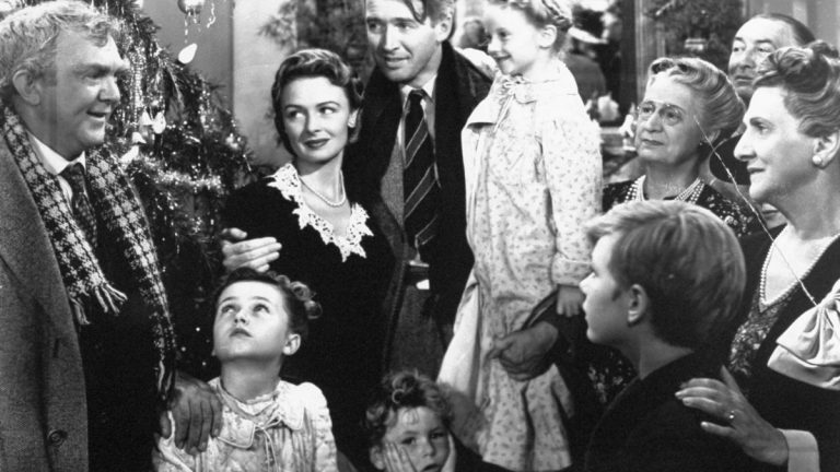 James Stewart, center, is reunited with his wife, Donna Reed, left, and children during the last scene of Frank Capra's