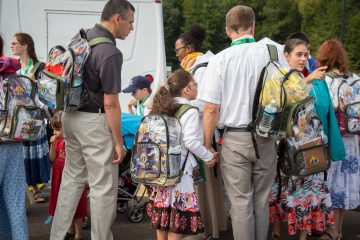 Over 700 people que up at the Woodbourne SEPTA train station on their way into the city to see Popr Francis speak from the steps of the Philadelphia Art Museum. Over 1000 visitors will pass through this station today on their way to the various World Meeting of Families 2015 events in the heart of Phladelphia. (Emily Cohen/for NewsWorks)