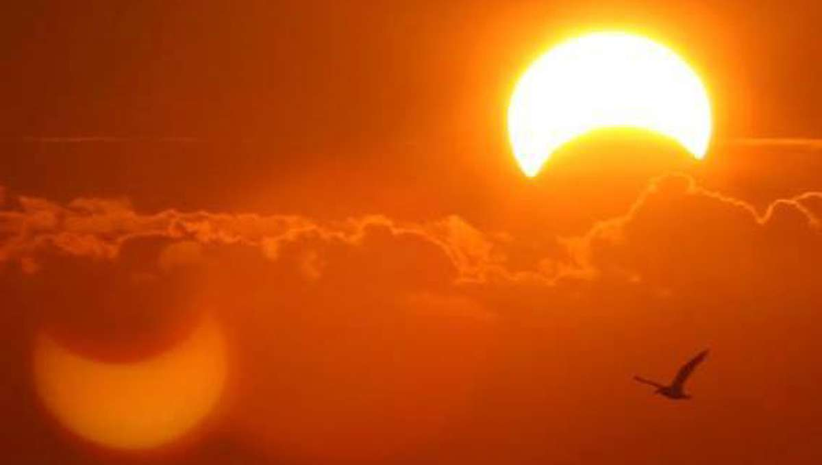 Sunday's partial solar eclipse as seen from Brant Beach on Long Beach Island in N.J. (Photo by Peter Maschal)