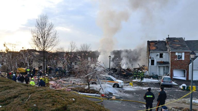 Smoke was visible five hours after an explosion destroyed 10 townhomes in Ewing, N.J. (Bas Slabbers/for NewsWorks)