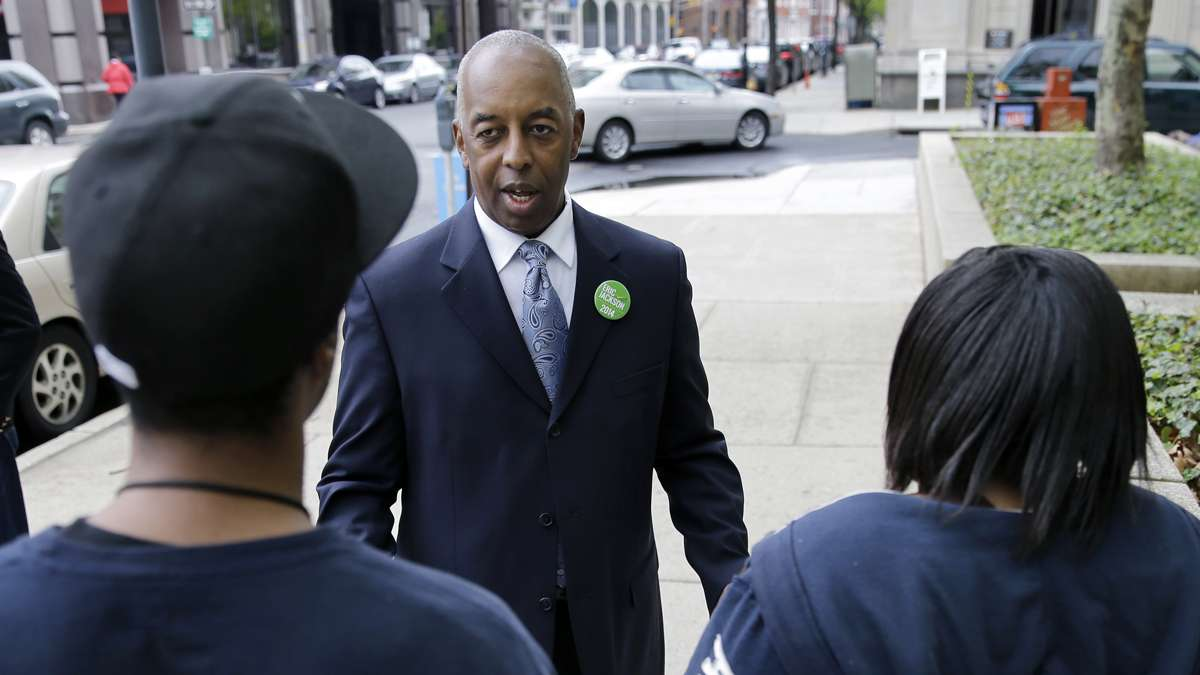 May 8, 2014 mayoral candidate Eric Jackson greets a couple in downtown Trenton.  (AP File Photo/Mel Evans)