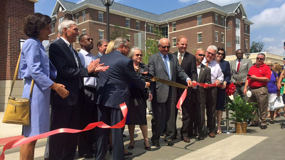 The red ribbon was cut at The College of New Jersey's 'Campus Town' project on Aug 19, 2015. (Alan Tu/WHYY)