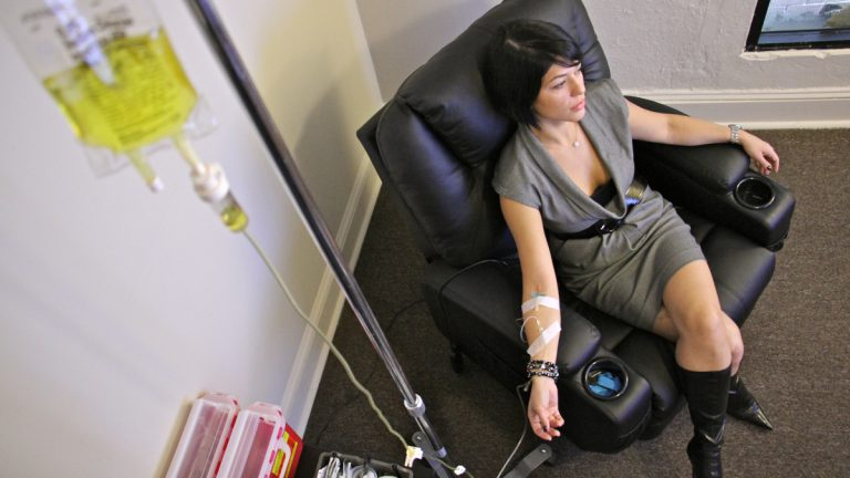 Yana Shapiro relaxes while taking a vitamin IV at RestoreIV (Emma Lee/WHYY)