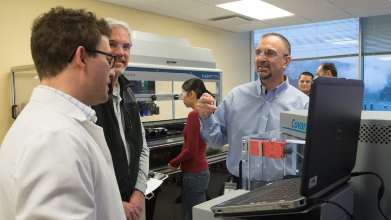 George Yancopoulos,  Regeneron's chief scientific officer; Dr. Scott Mellis; and John Overton are shown in the DNA sequencing labs at the Regeneron Genetics Center in Tarrytown, N.Y. (Image courtesy of Doug Abdelnour)