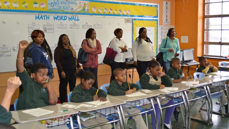 Parents tour a classroom at Young Scholars Kenderton. (Kevin McCorry/WHYY)