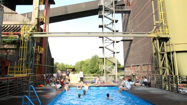 A swimming pool amidst the old structures at Zollverein, a former coal mine that was turned into a park and cultural space. (Marielle Segarra/WHYY)