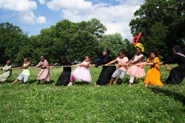 Children play a game of tug of war at Eid al-Fitr festivities in FDR Park in South Philadelphia, Sunday, June 25, 2017. (Annie Risemberg for NewsWorks)