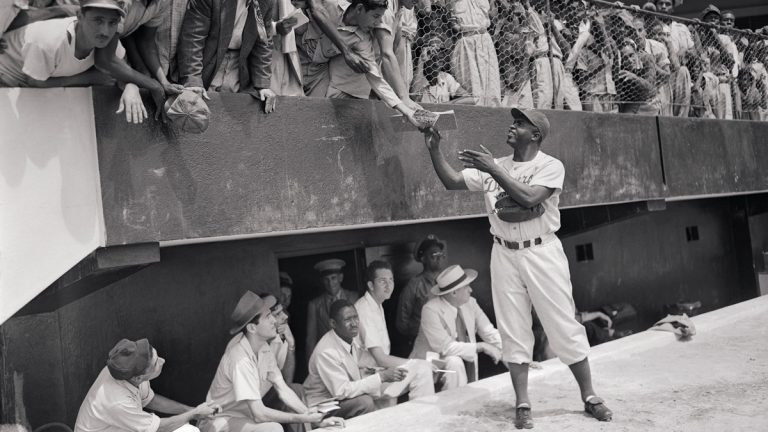 "Jackie Robinson signs autographs at spring training with the Brooklyn Dodgers, March 06, 1948, part of ""Chasing Dreams: Baseball and Becoming American,"" opening March 13 at the National Museum of American Jewish History. (Photo courtesy of NMAJH)"