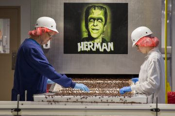 Workers check pieces of candy at the Gertrude Hawk Chocolates manufacturing facility near Scranton, Pennsylvania. (Lindsay Lazarski/WHYY)