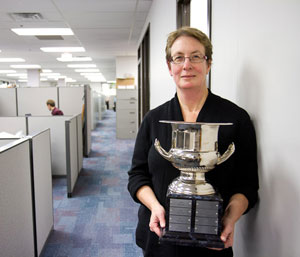 Campbell's Jan Kelly holds a trophy awarded as part of the incentive program.