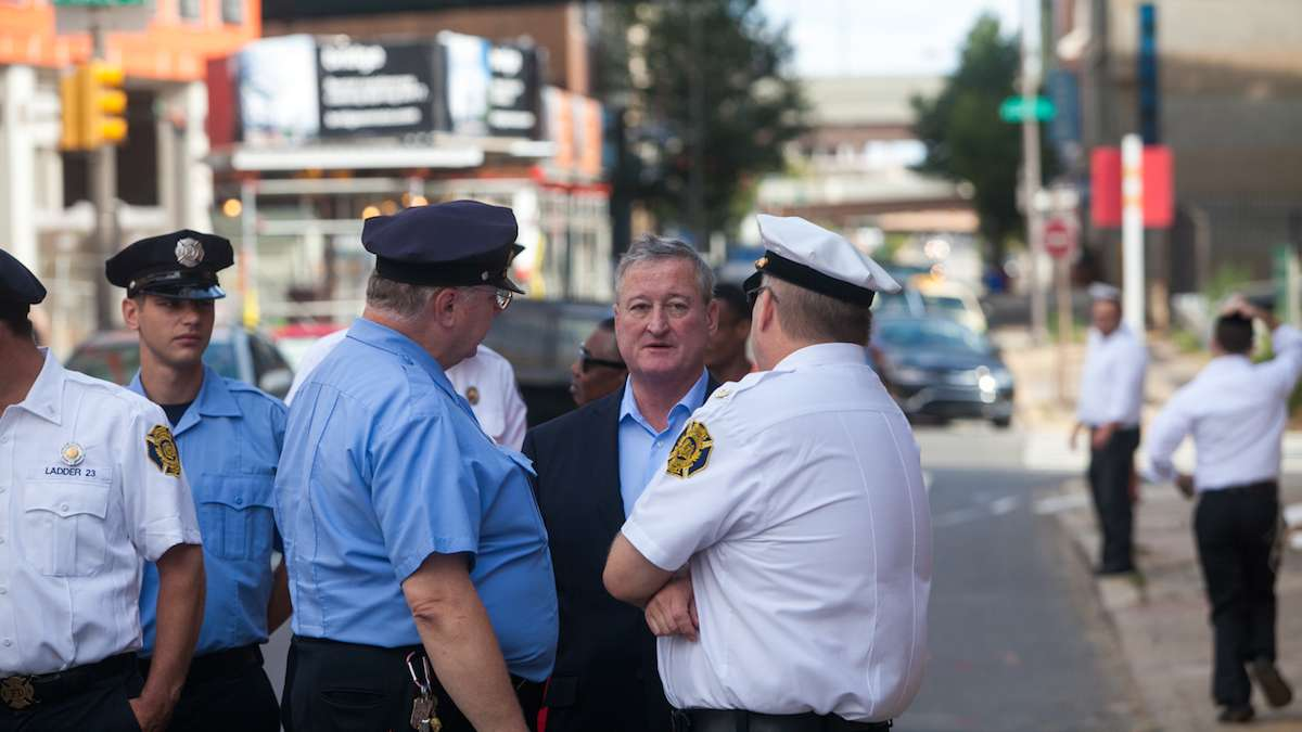 Mayor Jim Kenney chats with Philadelphia Firefighters before marching to the Betsy Ross House for a ceremony honoring first responders on the 15th anniversary of the September 11th terror attacks.