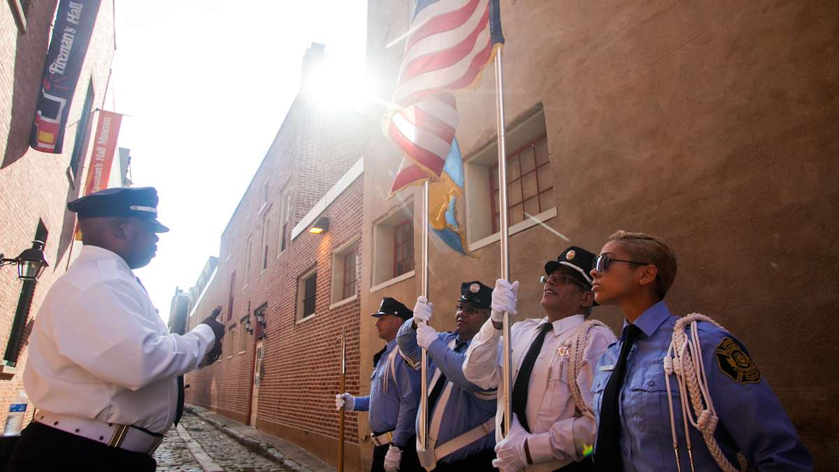Members of the Philadelphia Fire Department Color Guard practice before marching on the 15th anniversary of the September 11th attacks on the World Trade Center.