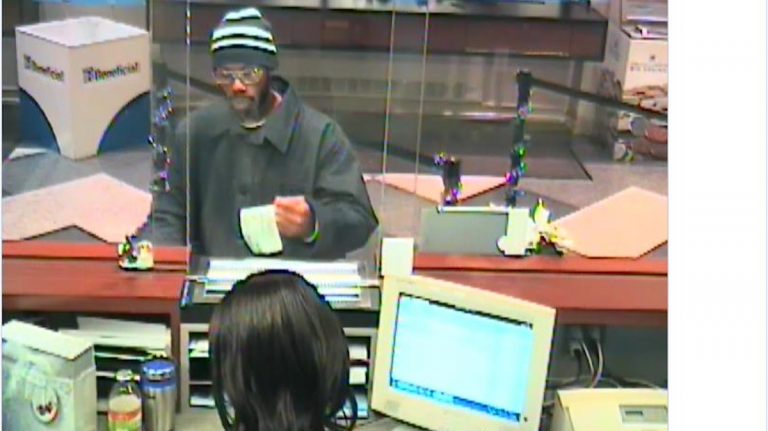 The suspect is seen here during an attempted robbery at a bank on 16th and Chestnut. Police believe he is the same man who robbed the Valley Green Bank at 7226 Germantown Ave. on Dec. 18. (Courtesy of the Philadelphia Police Dept.)