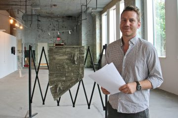 James Merle Thomas, executive director of Vox Populi artists collective, has wrangled a gallery space at 990 Spring Garden. (Emma Lee/WHYY)