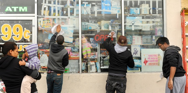 <p><p>The front of a dollar store is cleaned at Atlantic and Florida avenues in Atlantic City. (Photography by Peter Tobia/Atlantic City Alliance)</p></p>