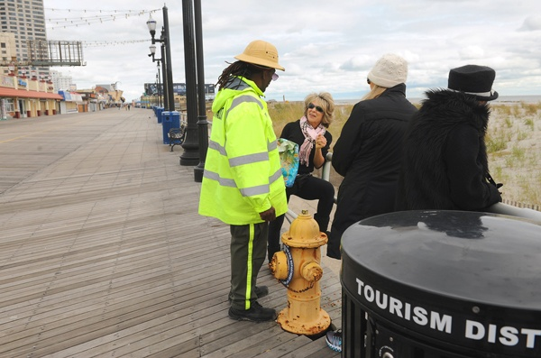 <p><p>Ambassador Dwight King with the Casino Reinvestment Development Authority talks with people out on the Boardwalk. The Boardwalk in front of the casinos was not damaged by the storm. (Photography by Peter Tobia/Atlantic City Alliance)</p></p>