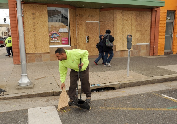 <p><p>Casino Reinvestment Development Authority workers clean up debris at Atlantic and Florida avenues. (Photography by Peter Tobia/Atlantic City Alliance)</p></p>