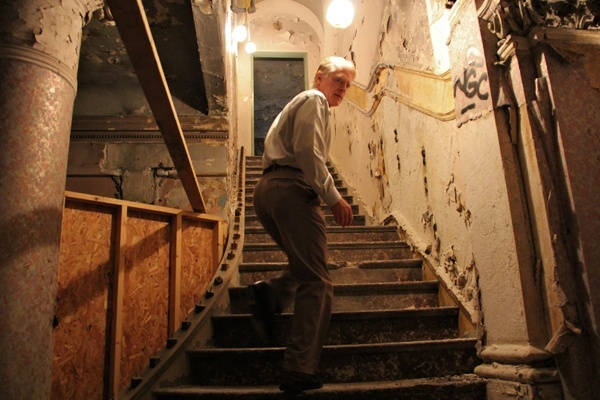 <p><p>Bill Deasey, director of leasing for EB Realty Management, leads visitors up the marble staircase of the Divine Lorraine. (Emma Lee/for NewsWorks)</p></p>