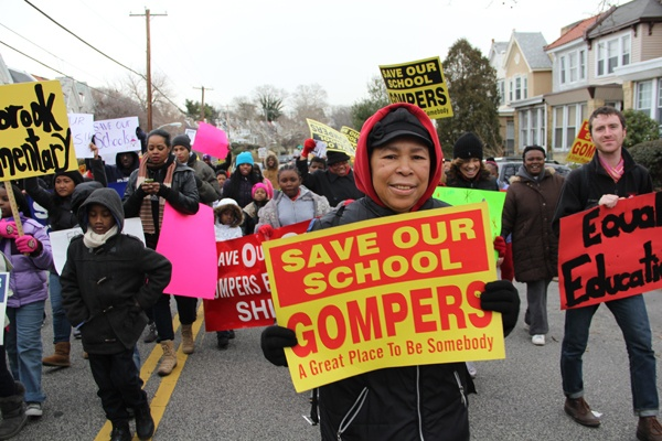 "<p><p>Singing ""We Shall Overcome,"" and chanting ""the people united will never be defeated,"" about 150 protesters marched around the West Philadelphia nieghborhood surrounding Gompers Elementary School to protest school closings. (Emma Lee/for NewsWorks)</p></p>"