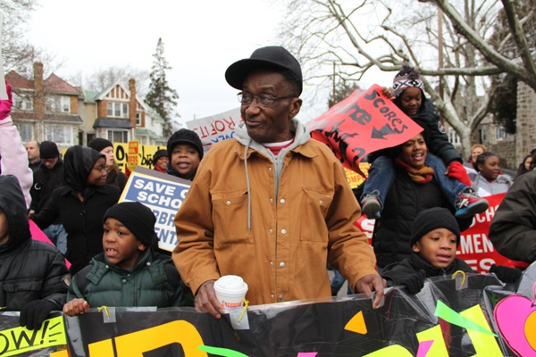 "<p><p>ElVee Pryor, who has three children at Overbrook Elementary, joins the march to save the school. ""They just spent over a half million dolllars to fix it up, now they're going to shut it down,"" he said. (Emma Lee/for NewsWorks)</p></p>"