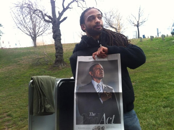 <p><p>Donte Samuel sells the <em>Washington Post</em> for $2.50 -- a commemorative super shot. (Kimberly Paynter/WHYY)</p></p>
