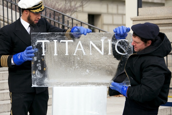 <p><p>Rob Capone and Don Harrison installing the Titanic sign in front of the Franklin Institute. (Nathaniel Hamilton/for NewsWorks)</p></p>