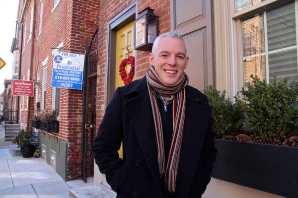 <p>Will Massey stands in front of his home in the Queen Village neighborhood, a section of the city that will see some of the highest tax increases. (Emma Lee/for NewsWorks)</p>