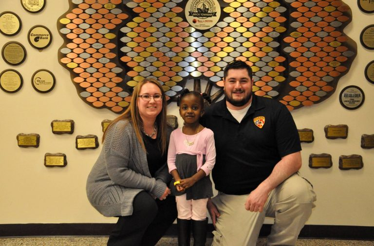 Kimberly Greenspan, Brick Township 911 Operator, and Public Safety Telecommunicator  Richard Incremona with the 3-year-old Brick Township girl who dialed 9-1-1 when she couldn't wake her mother. (Image courtesy of the Brick Township Police Department)