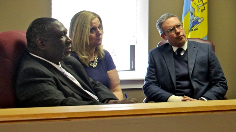 A lawsuit challenges whether the Philadelphia City Commissioners (from left) Anthony Clark, Lisa Deeley, and Al Schmidt, can impartially oversee the May primary election because there is a ballot question that could affect the office. (Emma Lee/WHYY)