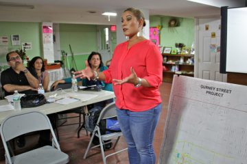 Joanna Otero-Cruz, deputing managing director for community services, prepares Kensington residents for the impact of the Gurney Street clean-up project. (Emma Lee/WHYY)
