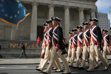 Members of The Old Guard, 3rd U.S. Infantry Regiment, march down Chestnut Avenue to the Museum of the American Revolution. (Emma Lee/WHYY)