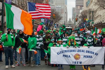 Members of Electricians Local Union 98 and their families march in the Saint Patrick's Day Parade on Market Street Sunday. (Brad Larrison for NewsWorks)