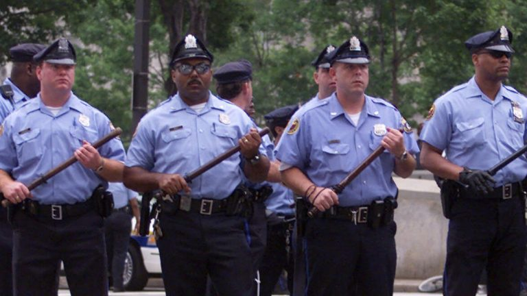 Philadelphia police are shown facing protesters outside of City Hall on the opening day of the 2000 Republican National Convention. (AP Photo/Rick Bowmer)