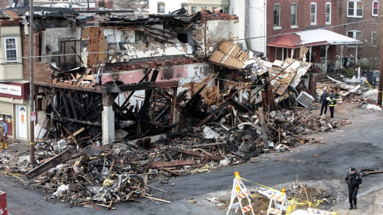 Shown on Jan. 19, 2011, is the site of a gas main explosion in Philadelphia. The gas main explosion, which was caught on video, sent a 50-foot fireball into the sky, killing a utility worker, injuring five other people and forcing dozens of residents from their homes.  (AP Photo/ Joseph Kaczmarek)