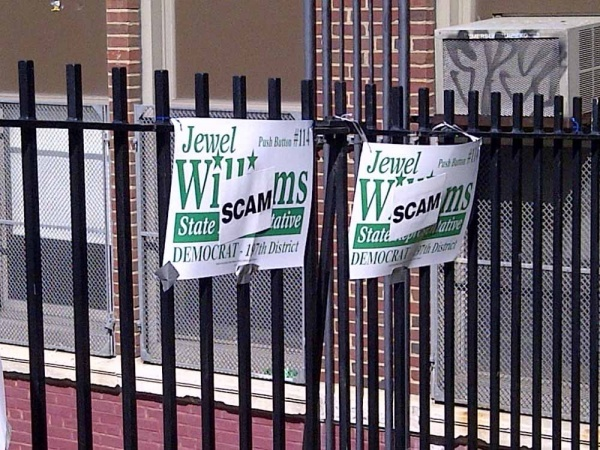 <p>&lt;p&gt;47.&#xA0; A group of people plastered Jewel Williams signs outside of Mifflin Elementary with stickers reading &quot;Scam&quot; (Brian Hickey/WHYY)&lt;/p&gt;</p>