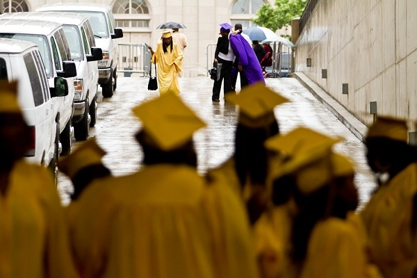 <p><p>23. A soon-to-be graduate gets a hug on a rainy afternoon before the start of the Martin Luther King High School graduation ceremony at the Liacouras Center on Tuesday. (Brad Larrison/for NewsWorks)</p></p>