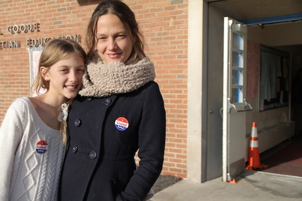 <p><p>Lola Culp-Osborne joins her mother Tara Culp at the polls. (Trenae V. McDuffie/for NewsWorks)</p></p>