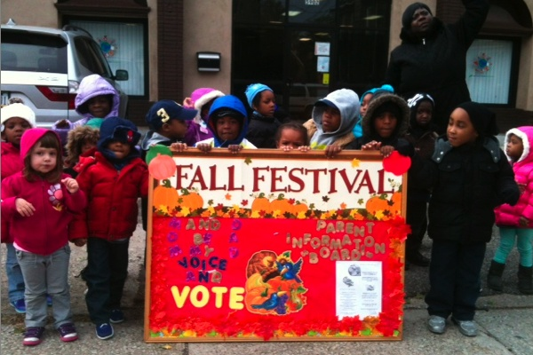 <p><div>Children from Arising Futures childcare and development center urge passersby to vote at Greene and Rittenhouse streets in Germantown. (Shai Ben-Yaacov/WHYY)</div></p>