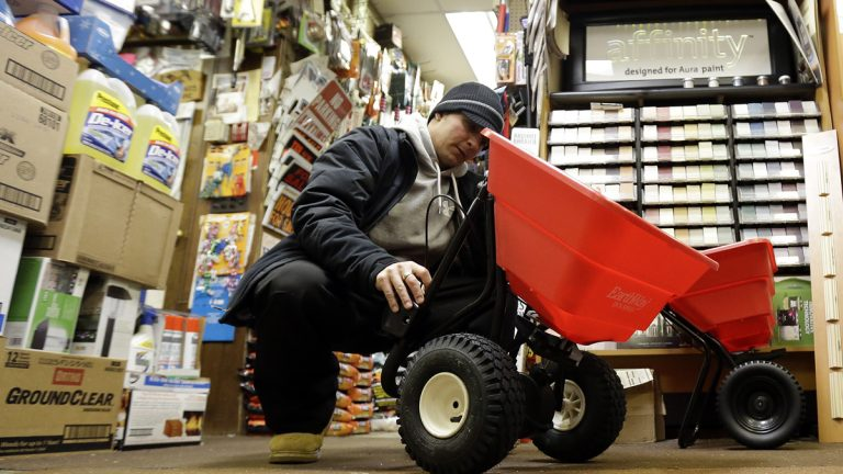 Marco Iuele inspects a salt spreader while shopping at Meadowlands Hardware, Jan. 2, 2014, in East Rutherford, N.J. (AP Photo/Julio Cortez)