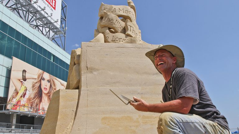 Atlantic City firefighter and professional sand sculptor Matthew Deibert. (Kim Paynter/for NewsWorks)