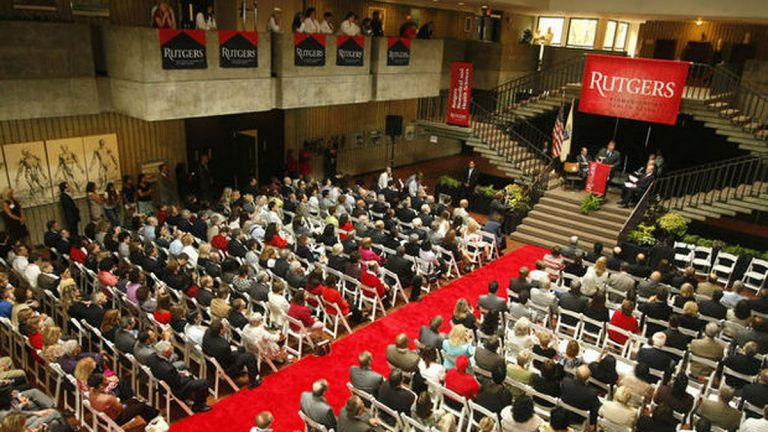 New banners are unfurled during a Rutgers ceremony to mark Rutgers University's takeover of most of the University of Medicine and Dentistry of New Jersey. Patti Sapone/ The Star-Ledger