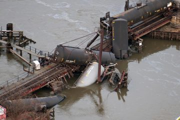 Derailed freight train cars lie in water in Paulsboro, N.J., in 2012. (AP Photo/Cliff Owen)