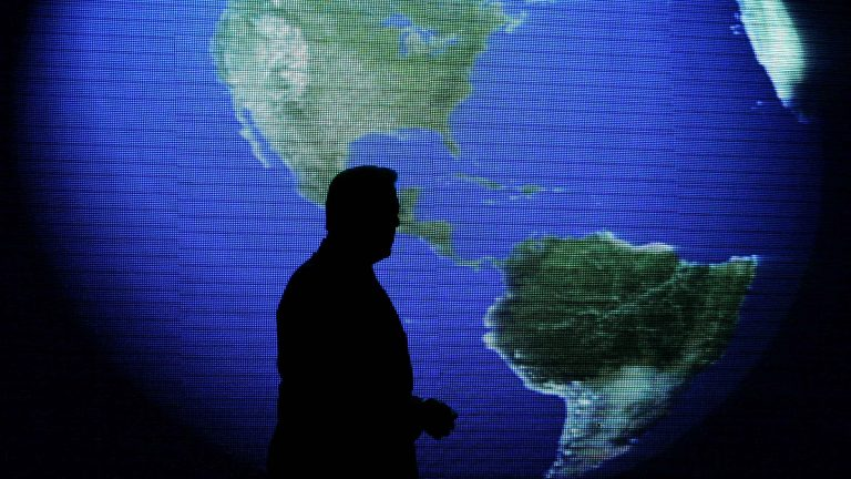Al Gore is silhouetted against an image of the earth during his talk about climate change in Manila, Philippines. (AP File Photo/Aaron Favila)